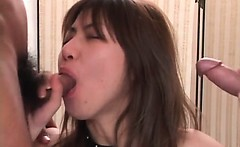 Jap hooker in fishnets orally satisfying two hard peckers