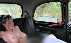 Busty British babe gives titsjob in fake taxi