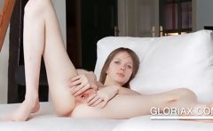Teenie showing her pussy hole in close-up