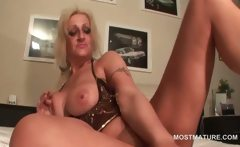 Dirty mature sucks a vibrator and plays with big tits