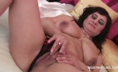 Slutty mature teasing her boobs and cunt in close-up