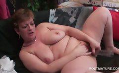 Lonely blonde mature masturbating with dildo at home